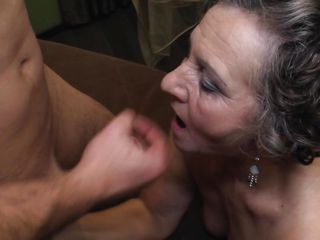 brunette granny riding a young hard cock
